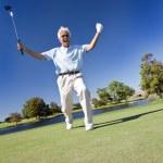 Senior Man Celebrating Playing Golf on Putting Green — Stock Photo #21599157