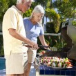 Happy Senior Couple Outside Cooking on A Summer Barbecue — Stock Photo
