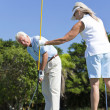 Happy Senior Couple Playing Golf & Putting Together — Stock Photo