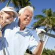 Royalty-Free Stock Photo: Happy Senior Man & Woman Couple Playing Golf