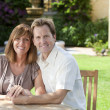 Stock Photo: Man & Woman Married Couple Sitting In Garden