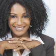 Stock Photo: Beautiful Smiling AfricAmericWomBusinesswoman