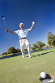 Senior Man Celebrating Playing Golf on Putting Green — Stock Photo