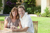 Man & Woman Married Couple Sitting In Garden — Stockfoto