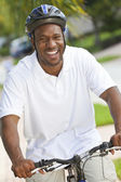 Happy African American Man Riding Bike Smiling — Stock Photo
