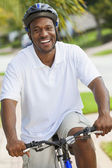 African American Man Riding Bicycle — Stock Photo