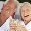 Happy Smiling Senior Couple Sitting On Park Bench Embracing — Stock Photo