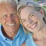 Happy Senior Couple Smiling Outside in Sunshine — Stock Photo #21638655