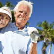 Happy Senior Couple Playing Golf Putting on Green — Stock Photo #21638847