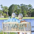 Rear View Senior Couple Sitting On Park Bench — Stock Photo