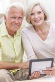 Senior Man & Woman Couple Using Tablet Computer — Stock Photo