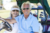 Senior Couple Playing Golf Driving Cart Buggy — 图库照片