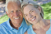 Happy Senior Couple Smiling Outside in Sunshine — Stock Photo