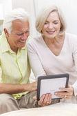 Senior Man & Woman Couple Using Tablet Computer — Stock Photo