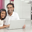 Asian Indian Father & Daughter Using Laptop Computer at Home — Zdjęcie stockowe #21640541