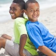 Young African American Boys Sitting Playing on Beach — Stock Photo