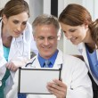 Male Female Hospital Doctors Using Tablet Computer — Stock Photo