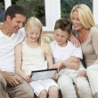 Stock Photo: Happy Family Having Fun Using Tablet Computer At Home
