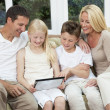 Happy Family Having Fun Using Tablet Computer At Home — Stock Photo #21643507