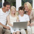 Happy Family Having Fun Using A Computer At Home — Stock Photo