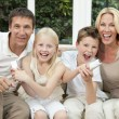 Happy Family Having Fun Playing Video Console Games — Stock Photo #21643535