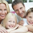 Happy Family Having Fun Sitting At Home - Stock Photo
