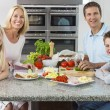 Parents Children Family Preparing Healthy Food - Stock Photo