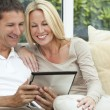 Happy Man & Woman Couple Using Tablet Computer — Stock Photo