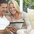 Happy Man & Woman Couple Using Tablet Computer — Stock Photo #21643607