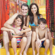 Mother Father Son Daughter Child Family Water Park - Stock Photo
