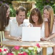 Family Using Laptop Computer Outside in Garden — Stock Photo