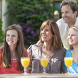 Parents Children Family Drinking Orange Juice Outside — Stock Photo