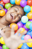 African American Girl Child Playing in Colored Balls — Stock Photo