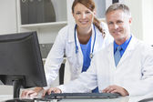 Male Female Hospital Doctors Using Computer — Stock Photo