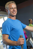 Middle Aged Man Running on Gym Exercise Machine — Stock Photo