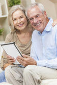 Happy Senior Man & Woman Couple Using Tablet Computer — Stock Photo