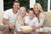 Happy Family Eating Popcorn Watching Television — Stock Photo