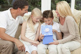 Happy Family Boy Child Opening Birthday Present At Home — Stock Photo