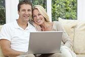 Happy Man & Woman Couple Using Laptop At home — Stock Photo