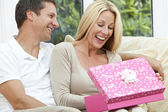 Happy Man & Woman Couple Opening Birthday Present — Zdjęcie stockowe