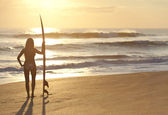 Woman Surfer In Bikinis With Surfboard At Sunset Beach — Stock Photo