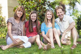 Parents Children Family Healthy Sitting In Garden — Stock Photo