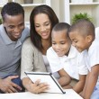 Stock Photo: African American Family Using Tablet Computer