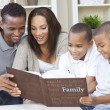 African American Family Looking At Photo Album — Stock Photo