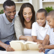 African American Mother Father Boys Family Reading Book — Stock Photo