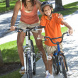 African American Woman Mother WIth Boy Son Riding Bike - Stock Photo