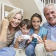 Grandparents & Children Family Playing Video Console Games - Stock Photo