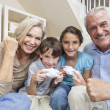 Grandparents &amp; Children Family Playing Video Console Games - Stock Photo