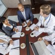 Interracial Medical Business Team Meeting in Boardroom - Zdjęcie stockowe