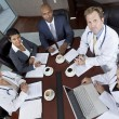 Interracial Medical Business Team Meeting in Boardroom — Stock Photo